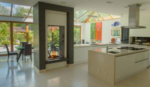 indoor/outdoor frameless bespoke fireplace