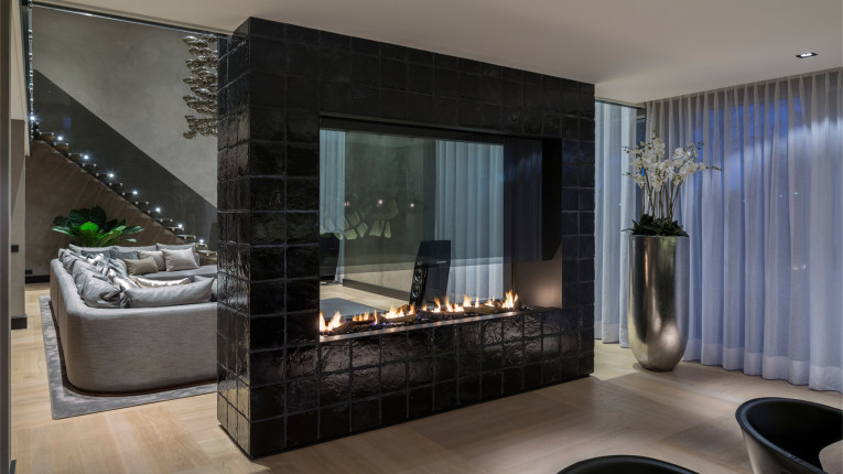 double sided fireplace with glass